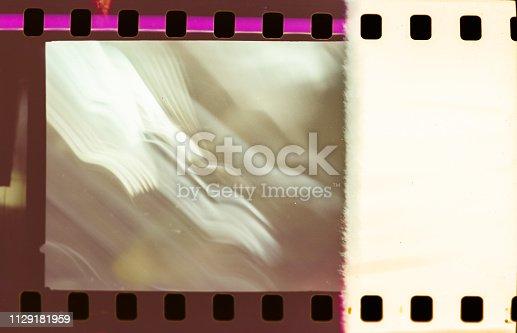 1152194399 istock photo Film strip texture background 1129181959
