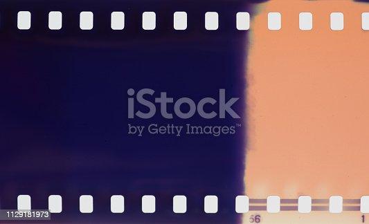 1152194399 istock photo Film strip texture background 1129181973