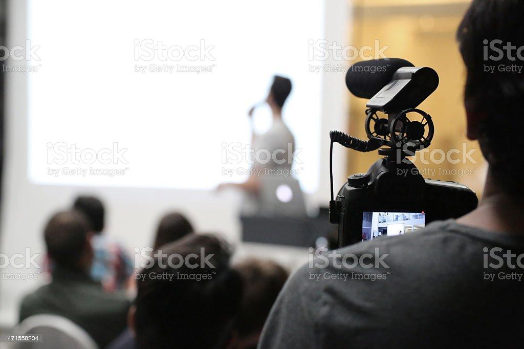 Filming a preseantation event stock photo