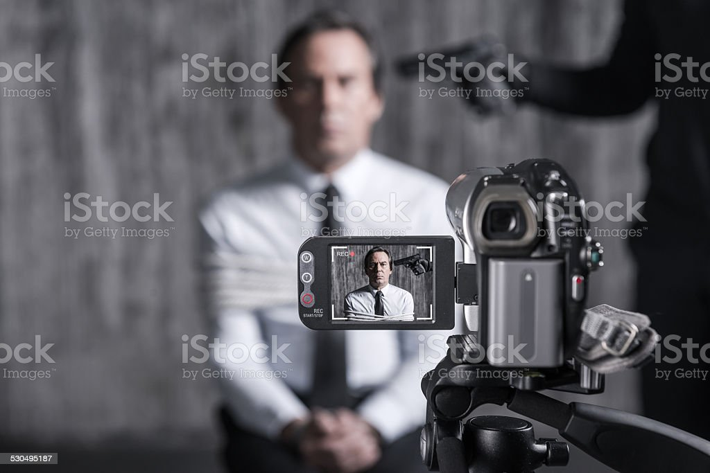 Filming hostage. stock photo