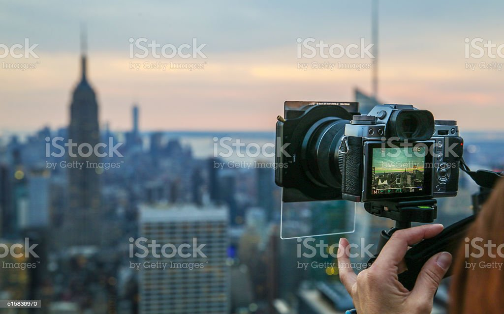 Filming New York Skyline at dusk - New York City stock photo