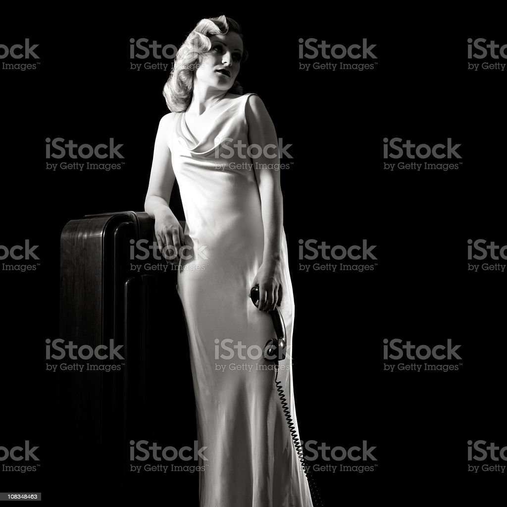Film-noir Portrait of Retro Woman Waiting With Old Phone. stock photo