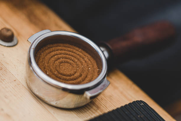 Filter Holder for coffee machine with wooden handle and coffee inside stock photo