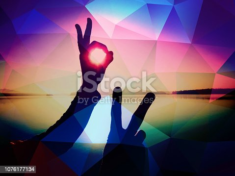 istock Filtered. Hand shadowplay symbol. Hands in the air 1076177134