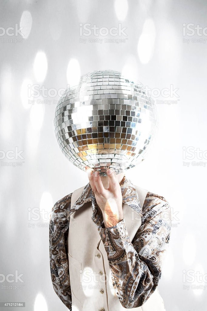 Filtered image of a man holding a disco ball stock photo