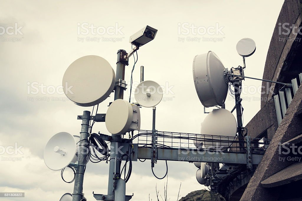 Filtered security camera with transmitters and aerials on telecommunication tower stock photo