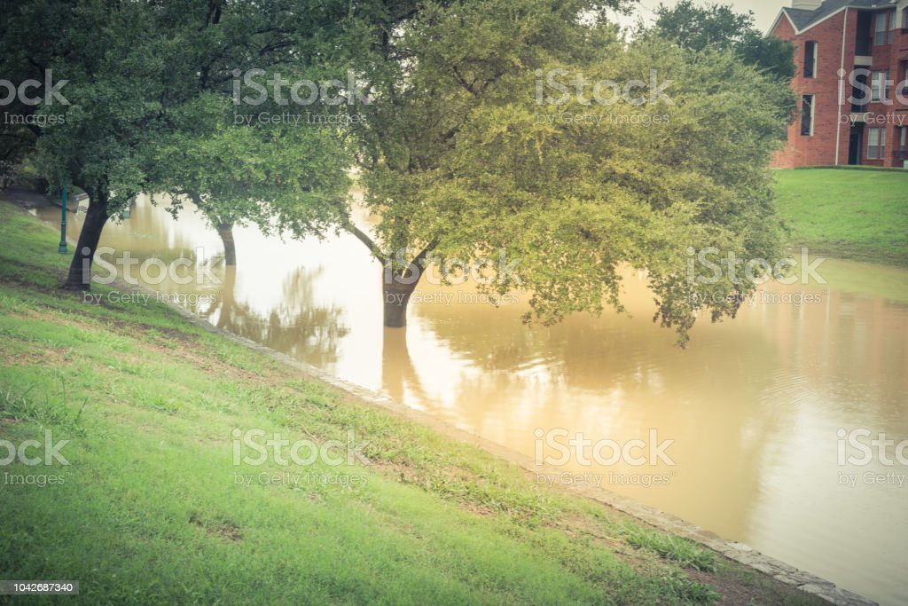 Vintage tone swamped riverside pathway near riverside apartment...