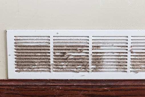 A filty dirty air duct - register.