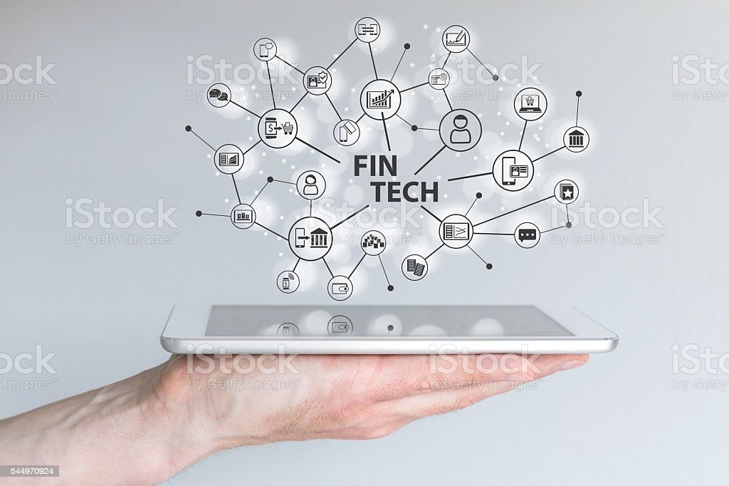 Fin Tech and mobile computing concept. Hand holding tablet stock photo