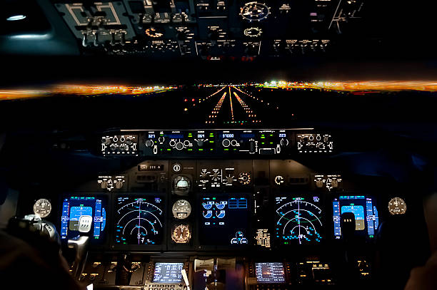 final approach at night - landing plane flight deck view - pilot stock photos and pictures