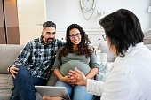 Doctor visit pregnant woman at home