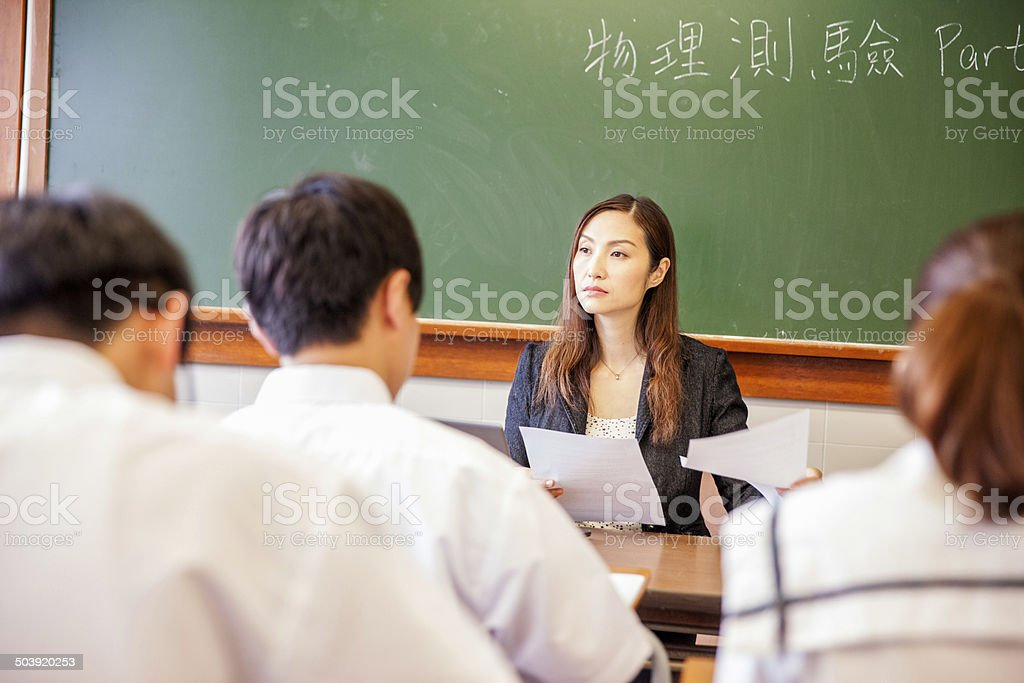 Student taking the final exam in the classroom