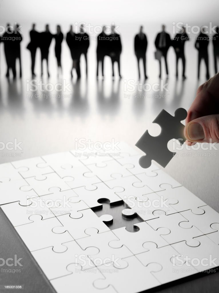 Final Piece in the Teamwork Puzzle royalty-free stock photo