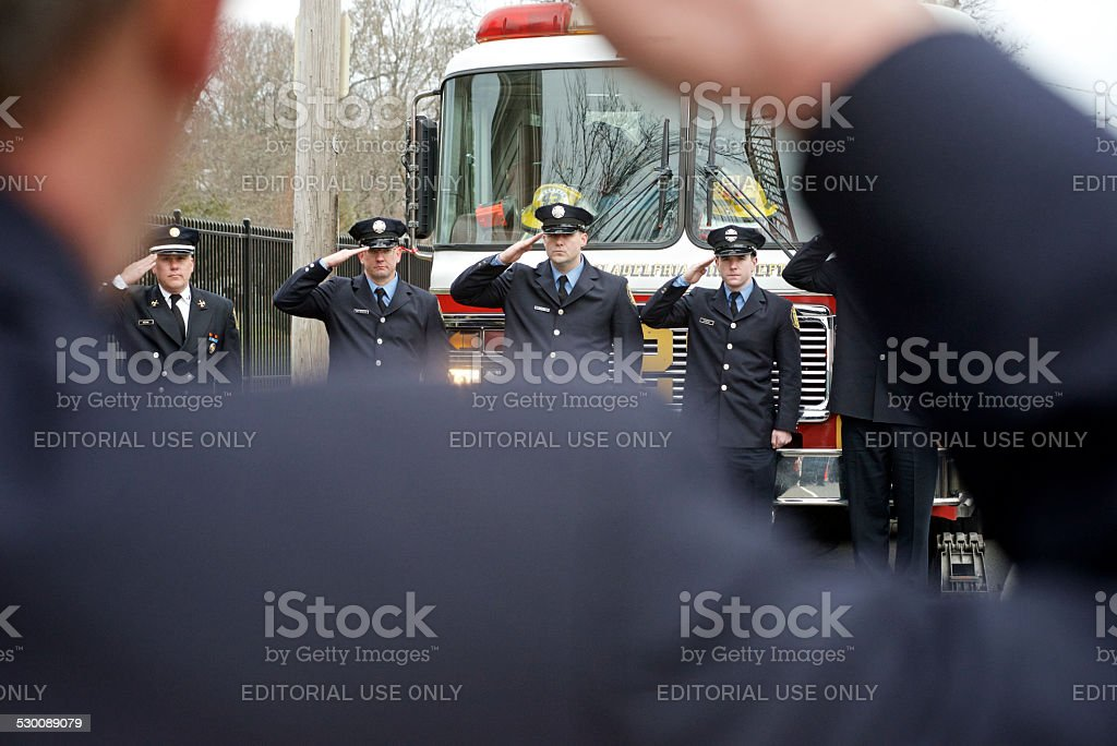 Final salute for female firefighter of Philalphia Fire Dept. royalty-free stock photo