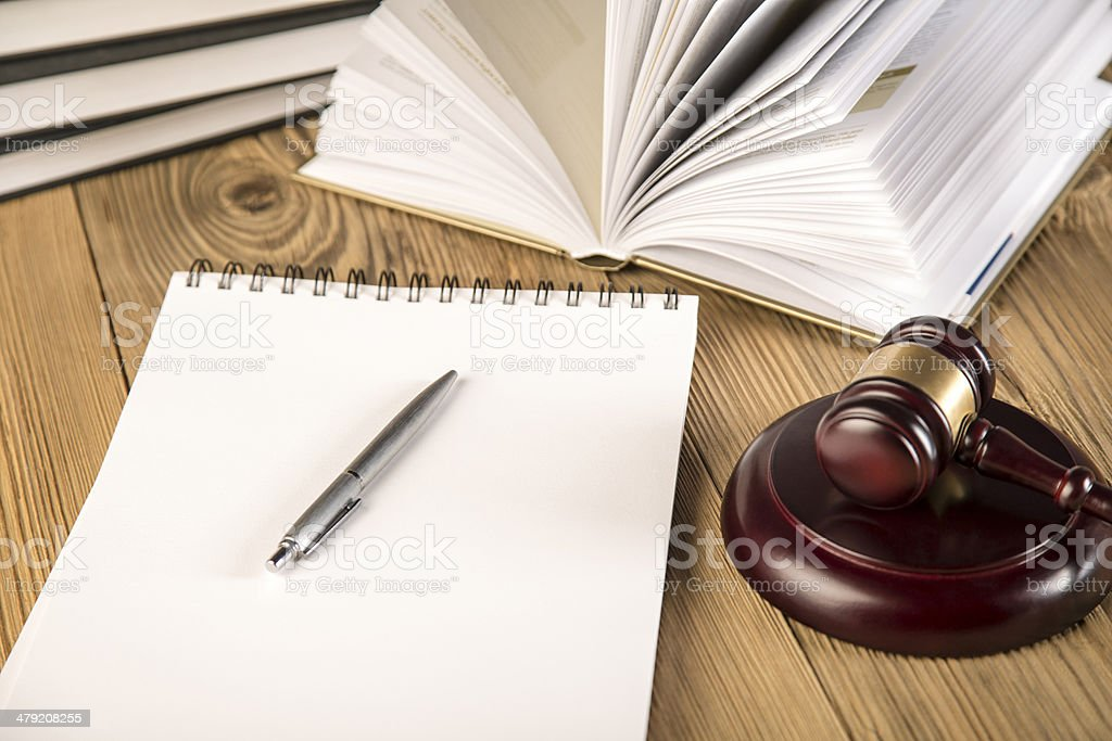 Final speech, Lady of justice, gavel and books on wood stock photo