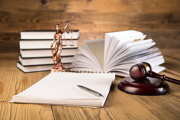Final speech, Lady of justice, gavel and books on wood