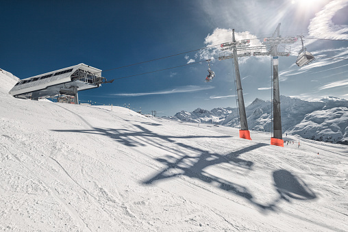 Final stop of a ski lift in the Swiss Alps with chair lift