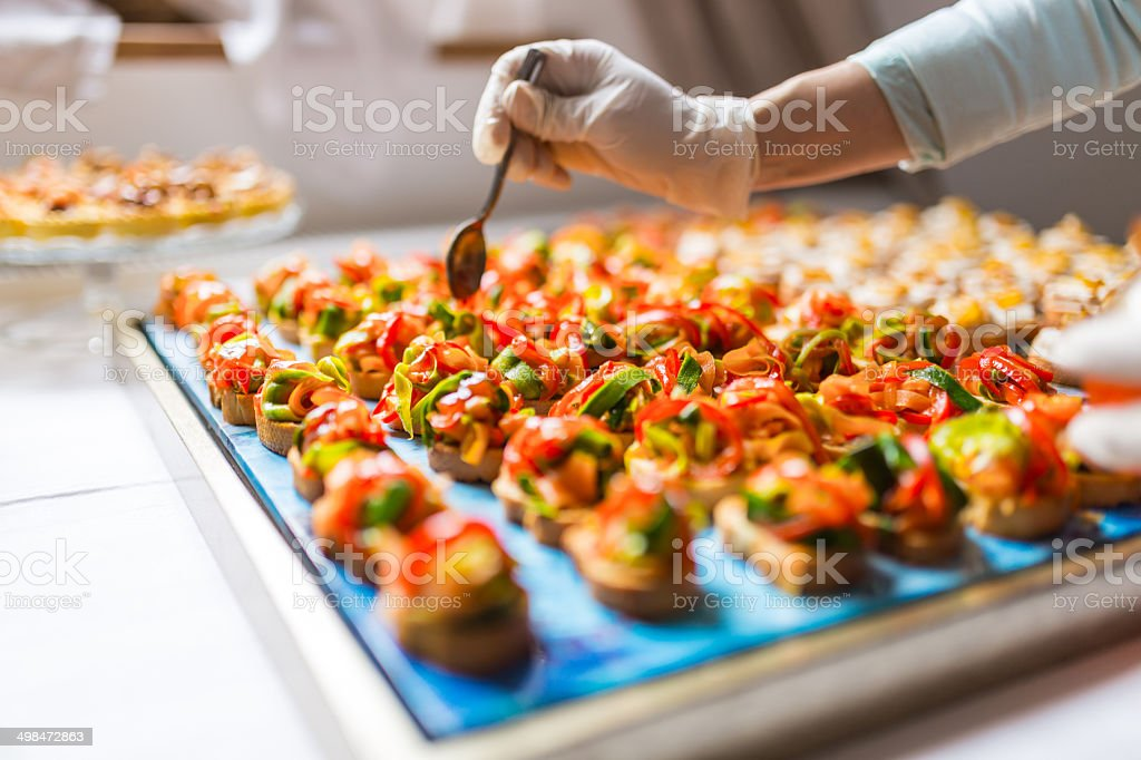 Final touch for tasty canapes stock photo