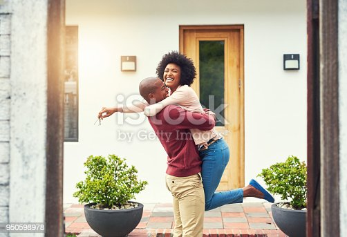 Shot of a young couple celebrating the move into their new house