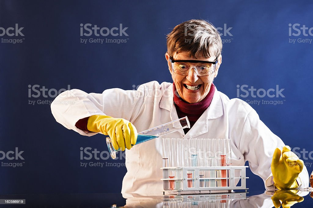 Finally, I have the formula! Mad female scientist at work stock photo