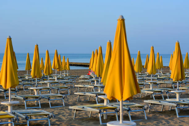 Finally the summer begins with the umbrellas still closed on the beach