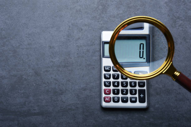 Financal concepts, a calculator showing zero with magnifying glass Financal concepts, a calculator showing zero with magnifying glass zero stock pictures, royalty-free photos & images