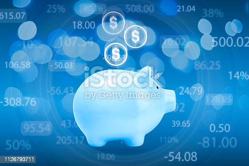 istock Finance and business concept, blue piggy bank with coins 1126793711
