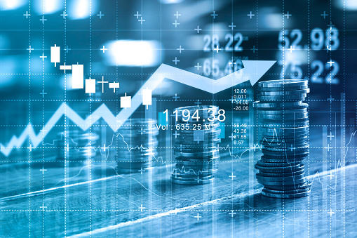 istock Finance and business concept. Investment graph and rows growth and of coins on table, blue color tone. 927888142