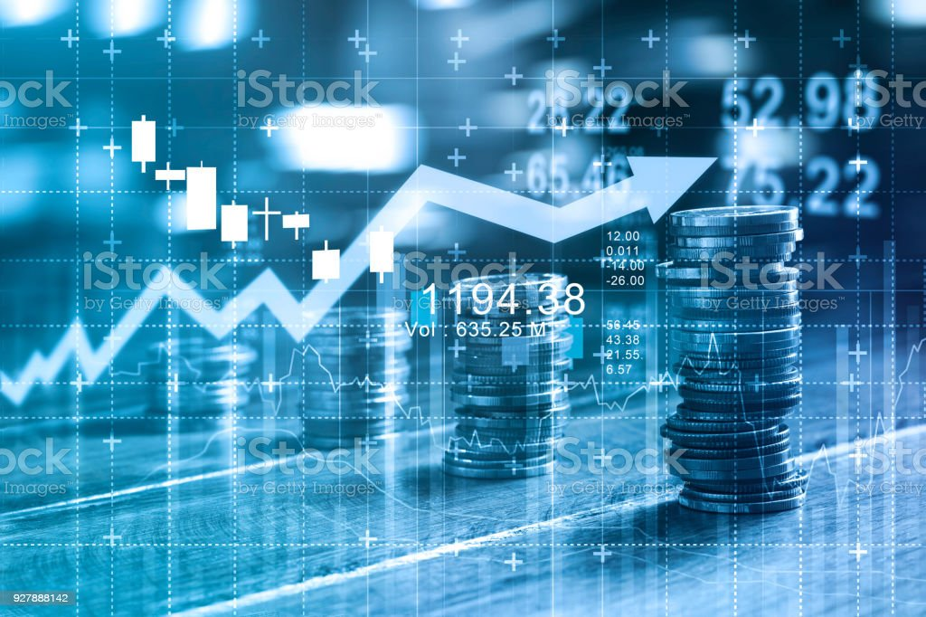 Finance and business concept. Investment graph and rows growth and of coins on table, blue color tone. stock photo