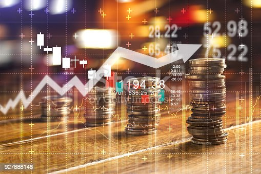istock Finance and business concept. Investment graph and rows growth and of coins on table 927888148