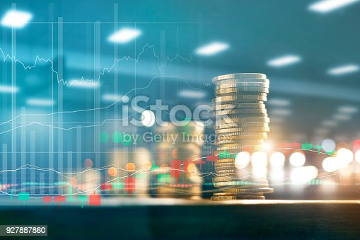 istock Finance and business investment concept. Graph and rows with statistic growth of coins on table. 927887860
