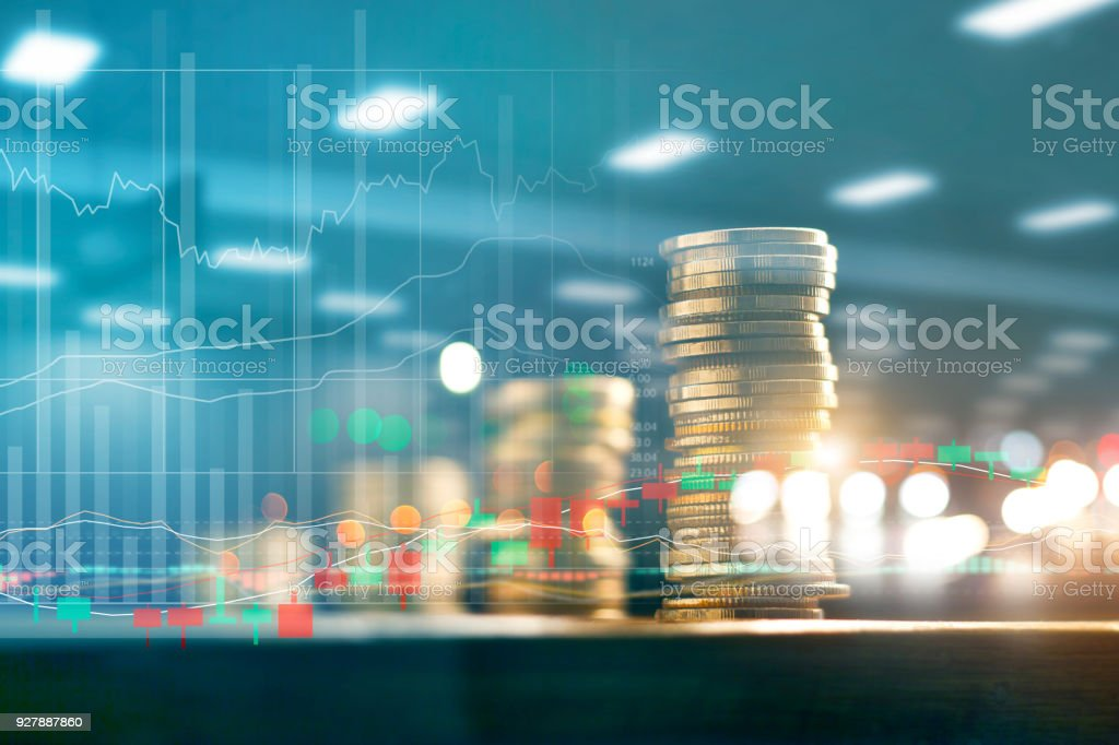 Finance and business investment concept. Graph and rows with statistic growth of coins on table. stock photo