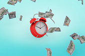 istock finance and economy concept Falling Money on blue background stock photo 1211224821