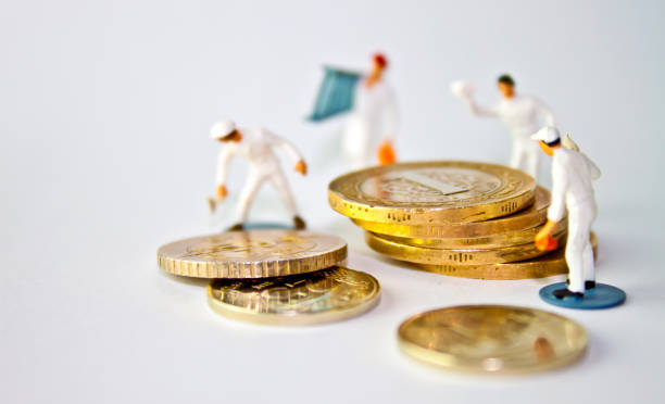 finance and economy concept - figurine stock photos and pictures
