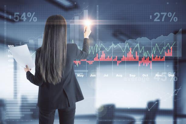 finance and forex concept - business woman hologram imagens e fotografias de stock