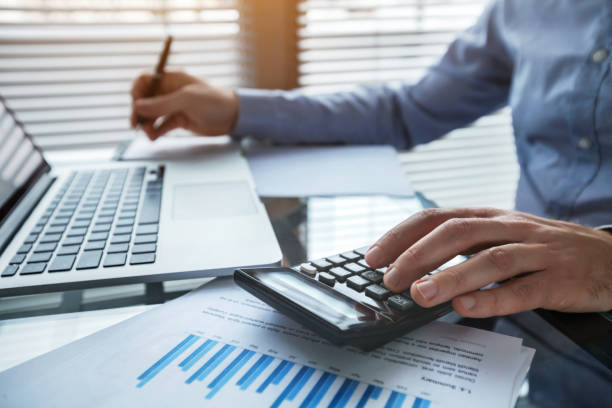 finance and investment, accounting, calculating taxes stock photo
