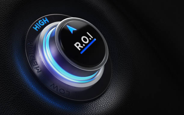 Finance And Investment Concept - ROI Labeled Button On A Car Dashboard stock photo