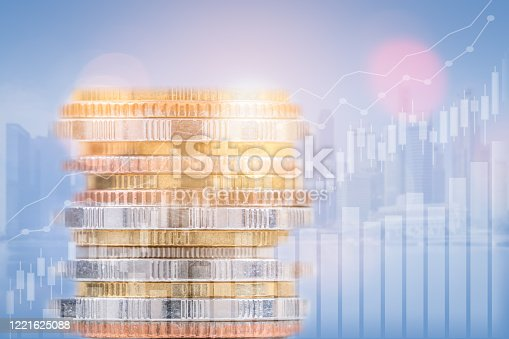 863469700 istock photo Finance, banking, and investment concept, double exposure of coins stack and city, with growing trend and candle stick graph. 1221625088