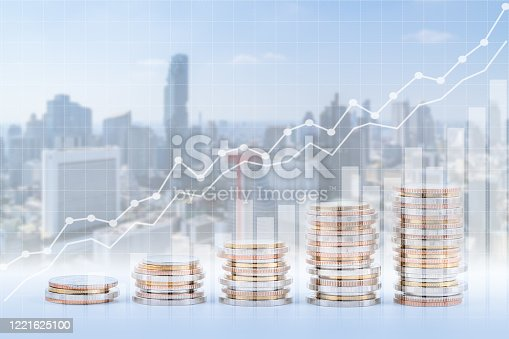 863469700 istock photo Finance, banking, and investment concept, double exposure of coins stack and city, with growing trend graph. 1221625100