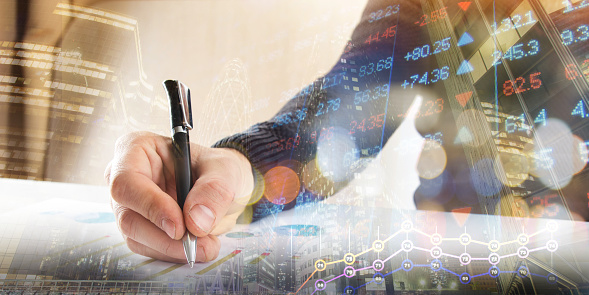 istock Finance, banking concept. businessman signs documents. Abstract image of Financial system with selective focus, toned, double exposure 891407678