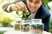 istock Finance broker demonstrating investment and savings growth 951524746