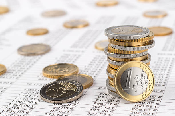 finance business euro stock background finance business accounting stock background with stack of euro coins on data sheet euro symbol stock pictures, royalty-free photos & images