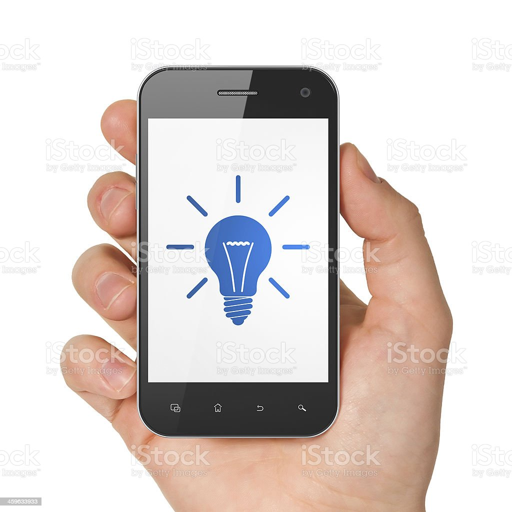 Finance concept: Light Bulb on smartphone Finance concept: hand holding smartphone with Light Bulb on display. Generic mobile smart phone in hand on White background. Abstract Stock Photo