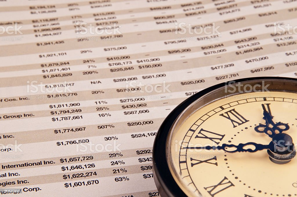 Finance concept with business paper and clock royalty-free stock photo