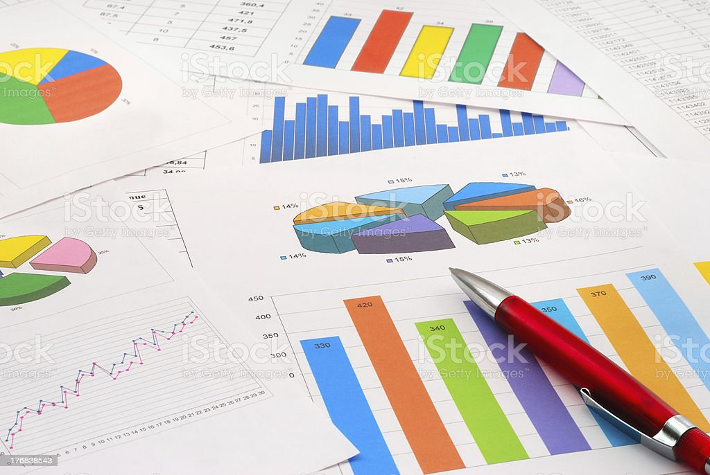 Finance documents as well as graphs and pie charts royalty-free stock photo