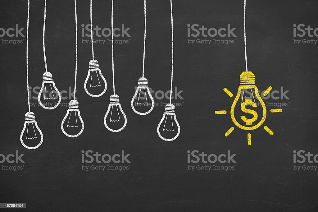 Finance Idea Bulb Concepts Drawing Working on Blackboard stock photo