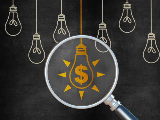 Finance Ideas Concept with Light Bulb on Blackboard stock photo