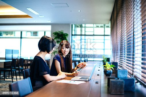 589445574istockphoto Finance minister assistants in Japan analyzing financial situation 598916366