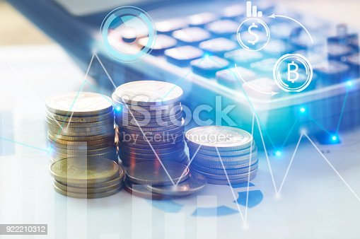 istock Finance, profit, capital banking and investment concept, Double exporsure stacked of coins and night city with graph 922210312