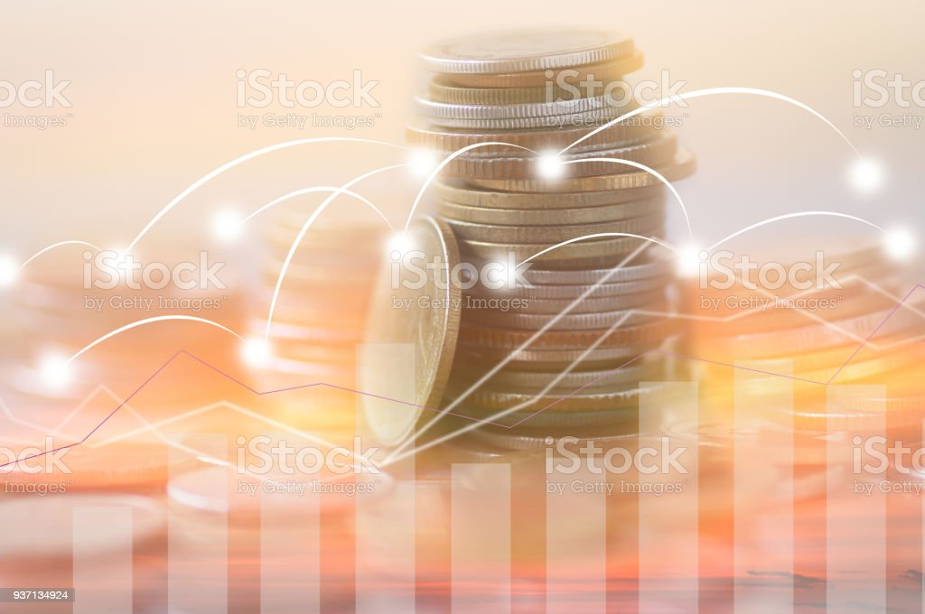 Finance, profit, capital banking and investment concept, Double exporsure stacked of coins and night city with graph stock photo